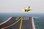 我航空母舰顺利进行舰载机起降训练现场